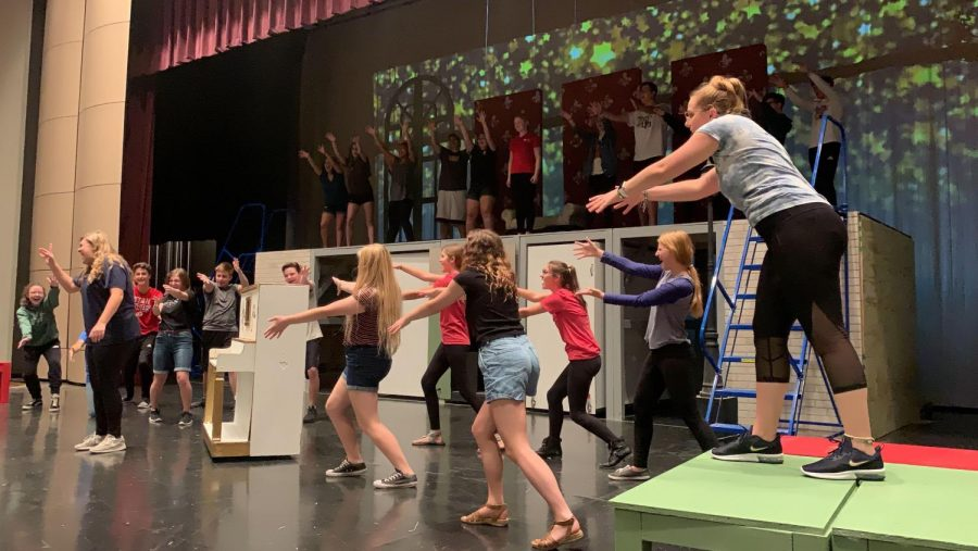 The cast of the musical preparing for their big show.