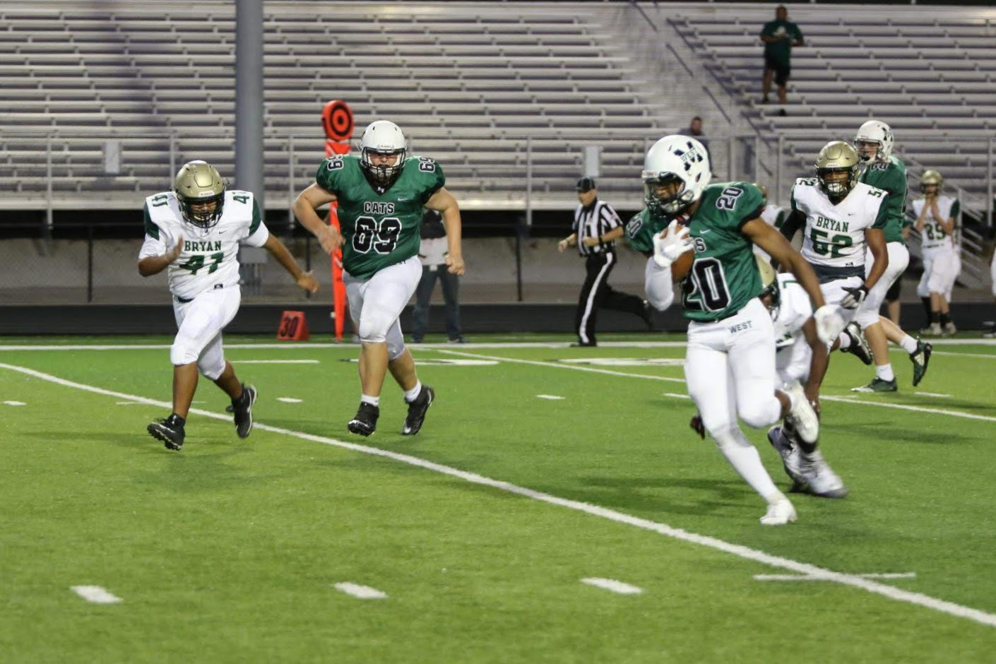 Zach Coleman runs the ball during Thursday's game against Bryan. The Wildcats outscored Bryan 74-6