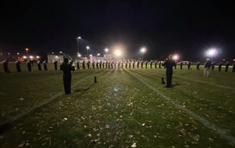 Millard West band lines the field at State. The members prepare for their last performance of this season.
