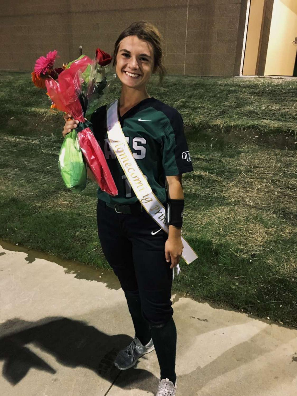 Surprised, junior Delaney Richardson finds out she won Homecoming Princess after her softball game. Her friends and family give her flowers and sash to her which she later on wears on Homecoming night.