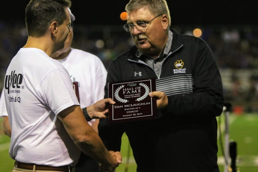 """Millard West's first football coach Dan McLaughlin shakes the hands of many as he receives his Hall of Fame plaque. He was a part of a special ceremony held at halftime of this year's first football game. """"I don't know if people really understand how special this place is,"""" McLaughlin said. """"When we first played here in 1995, we went 0-9, didn't win a single game, and none of them were even close. Look where it is now. The crowd, the atmosphere, the new scoreboard and field; it's a great place."""""""