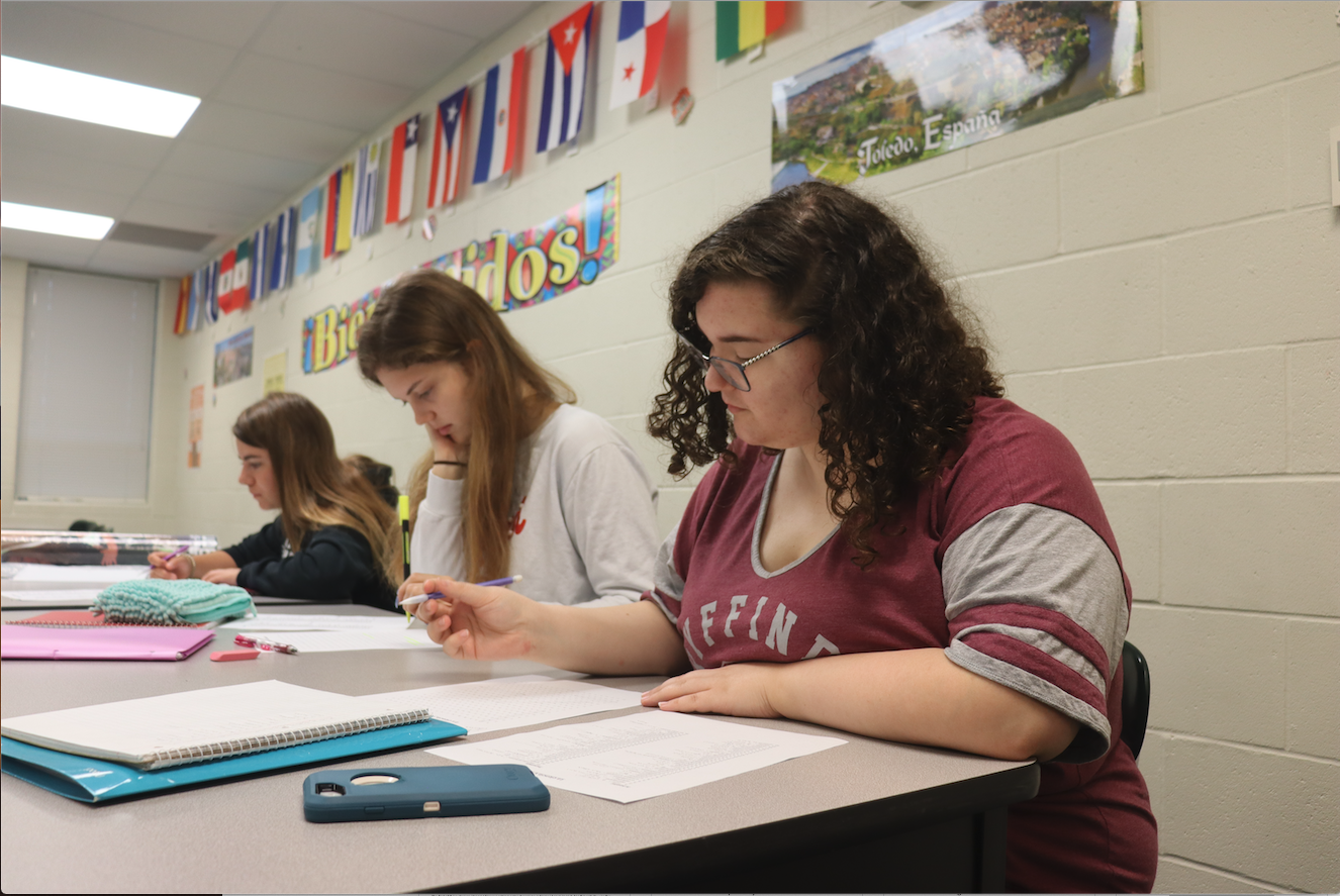"""Sarah Carron is writing down vocab words for Spanish class. She does her work to the best of her ability in all classes and strives to get good grades. """" We were copying down vocab words onto a note sheet to help us get used to using them,"""" Carron said. """"Then we used the new vocab to help us fill out a crossword puzzle."""