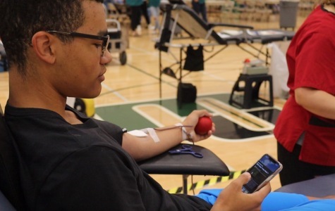 "Junior Trey Frazier donated blood on Friday. This is Frazier's third time donating for the HOSA blood drive. ""I donate blood because I want to help people who need it,"" Frazire said. ""I also really enjoy it."""