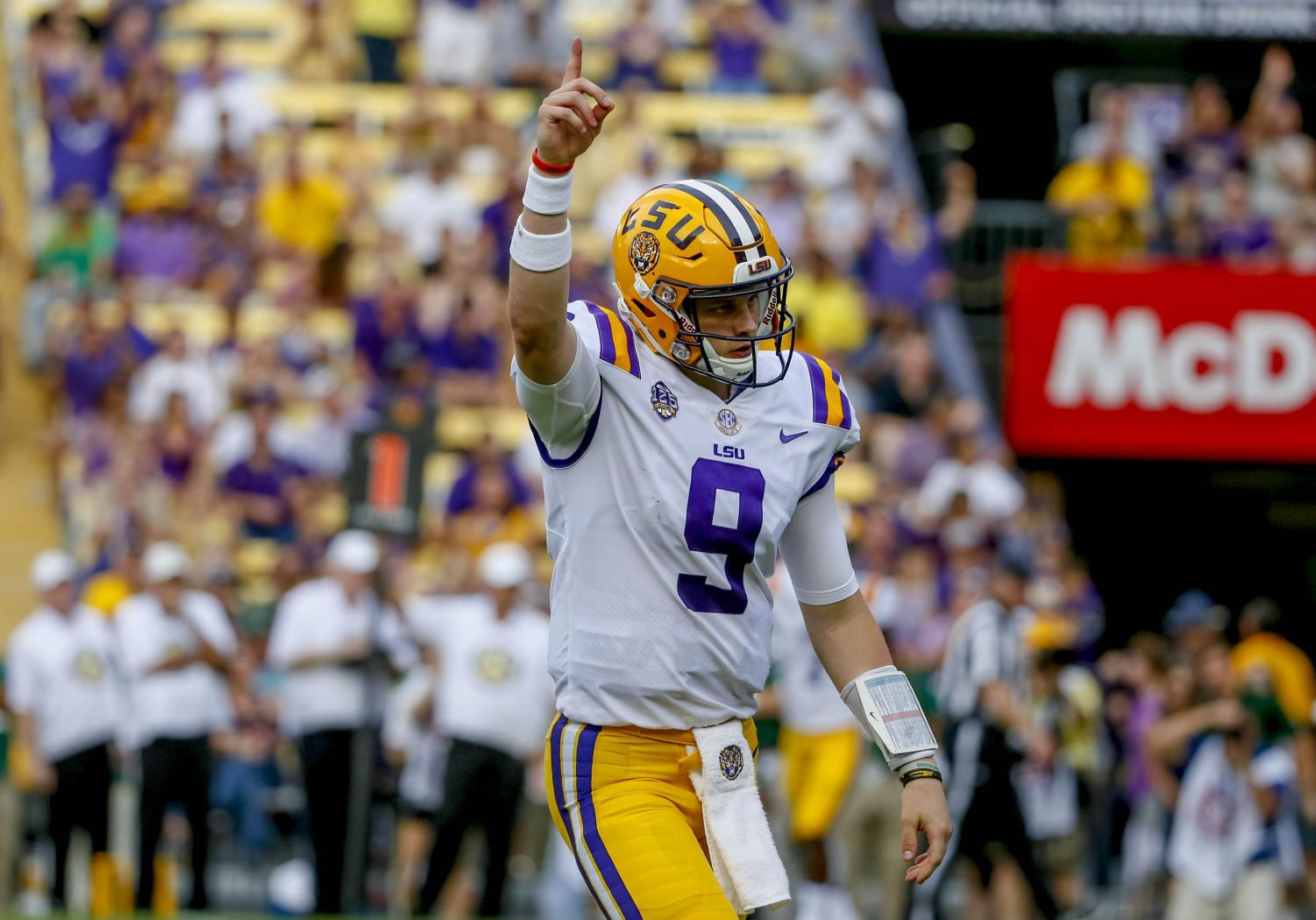 Joe Burrow celebrates a play for the LSU Tigers. Burrow has led them to the number one ranking and is top three in the country for every passing stat.