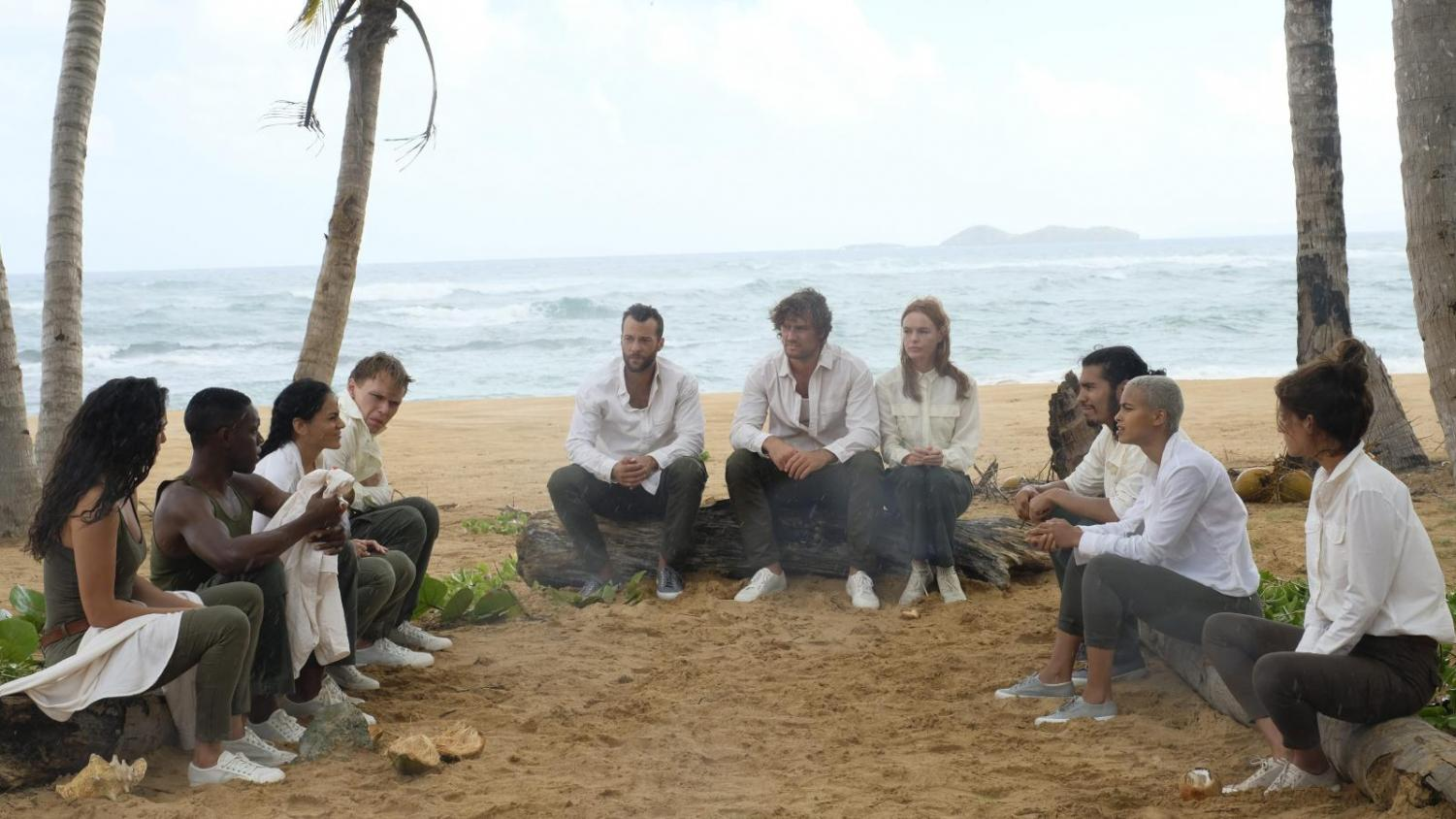 This picture shows the 10 islanders talking about what hey need to do to survive. This happens immediately after they wake up not having any memory or knowing anything about themselves. This scene pulls the viewer in and makes them want to know what is going on, so they keep watching.