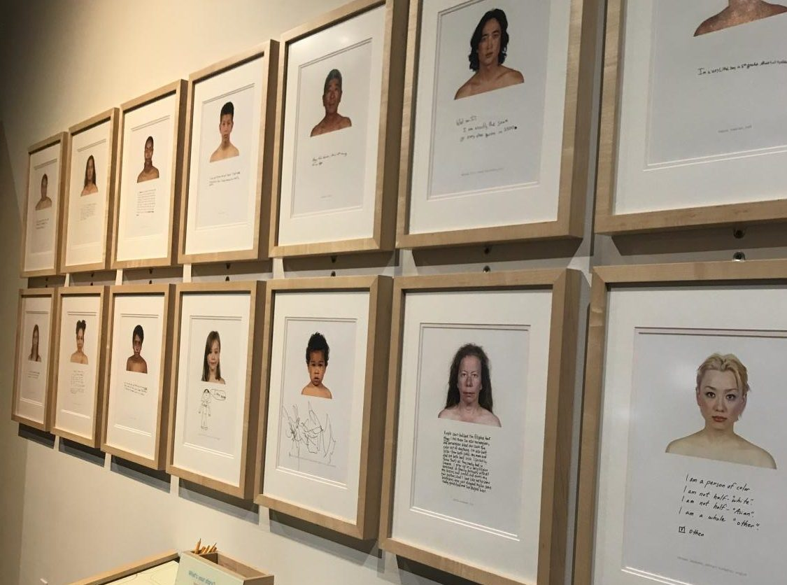 "Along one wall of the exhibit hangs portraits of several multi-ethnic individuals. Their ethnicities are listed, and then, in their own handwriting, they wrote about how they define their race and themselves. ""There wasn't any defining features that are distinct through race,"" Skoumal said. ""Fingerprints can't even be differentiated through race."""