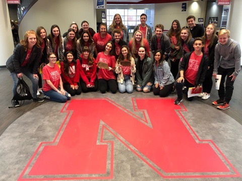 Millard West journalists pose in UNL with their awards they had won that day.