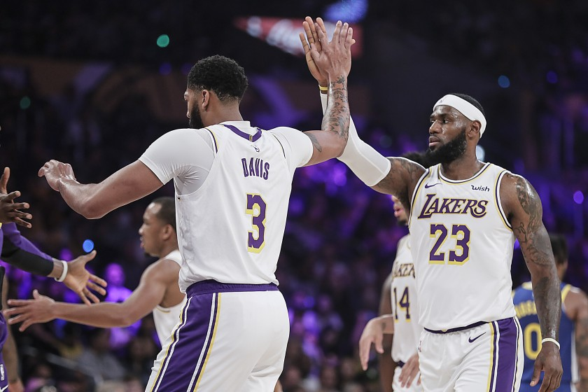 LeBron James and Anthony Davis celebrate after a defensive stop. The James and Davis duo has been anticipated around the league for months.