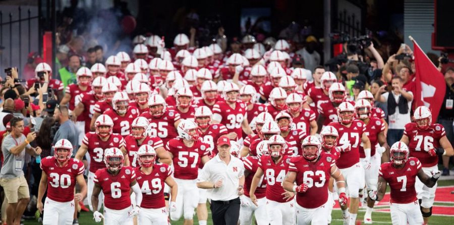Nebraska+is+pictured+running+out+after+the+tunnel+walk.++Scott+Frost+leads+them+onto+the+field+to+take+on+their+next+opponent.++The+team+hasn%E2%80%99t+been+playing+the+greatest++but+the+tunnel+walk+always+gets+everyone+pumped+up.