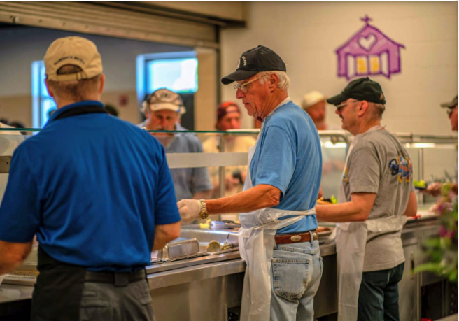 Adults and children alike volunteer their time at the Open Door Mission to help prepare and serve food. The Mission serves over 3,500 meals daily, and this would not be possible without the generous volunteers.