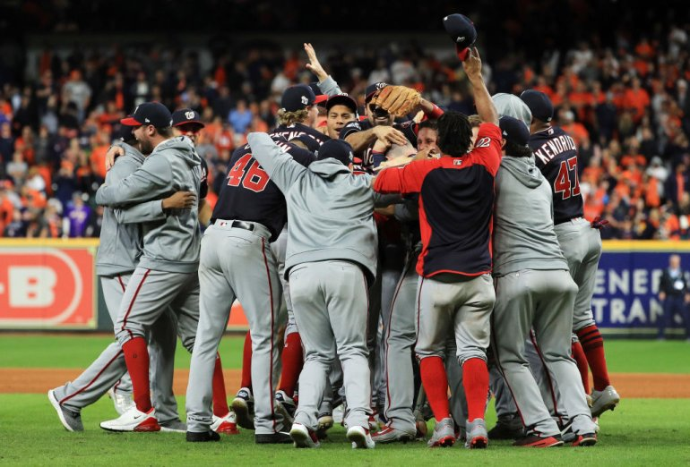 The+Washington+Nationals+are+pictured+dog-pilling+on+the+mound+after+winning+their+first+World+Series+championship+in+team+history.+From+now+on%2C+they+will+be+called+the+best+team+of+the+2019+MLB+season.