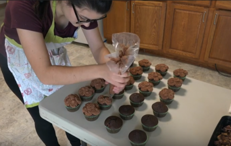 After creating the cake base for her cupcakes, senior Alissia Graybill must decide how she will choose to decorate. Here, she demonstrates her piping skills as she finishes her Chocolate Reeses cupcake with her decedent chocolate frosting. She then tops the cupcake with bits of the chocolate peanut butter candy.