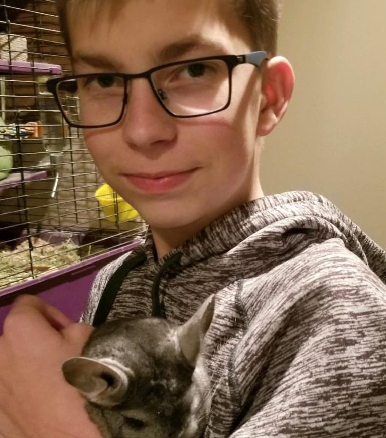 Pictured above is Gavin Christiansen with his unusual pet which is a chinchilla.