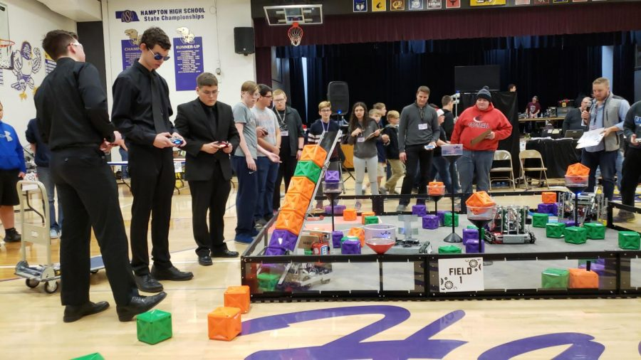 "Stacking up blocks with their robot, juniors Dominic Zohlen, Andrew Heftie and senior Tyler McCoid participate at their 3rd CREATE competition in Hampton, Neb. During their competition, the team had a few struggles at the start, but they still managed to push through and win a few awards. ""We have prepared long and hard for this competition and being able to spend a great time with teammates to present what we are capable of was really rewarding,"" McCoid said. ""I even got on the news with Channel 4 Hastings to voice out and explain how we performed on this CREATE Competition."""