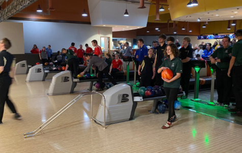 Bowen is pictured getting ready for her next turn to bowl in a meet. The team is behind her, cheering her on and hoping she does well.
