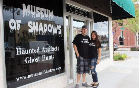 Owners of the Museum stand proudly infant of their business.