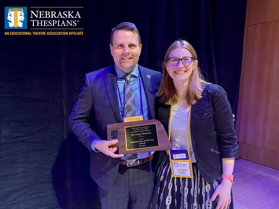 Principal+Greg+Tiemann+and+drama+director+Brooke+Phillips+side+by+side+accepting+Dr.+Tiemanns+administrator+of+the+year+award+at+the+annual+thespian+festival.+