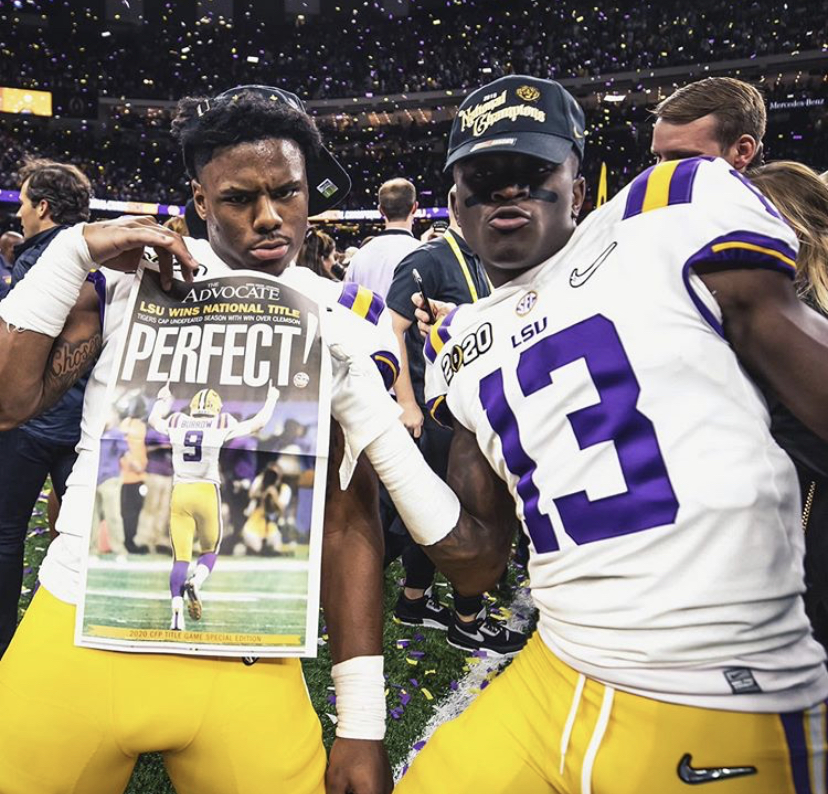 "LSU wide receivers Jontre Kirklin and Ja'marr Chase celebrate winning the national title. Chase totaled over 200 yards receiving against Clemson. ""We were the bigger dog in the fight,"" Chase said. ""We at the top of the mountain now."""