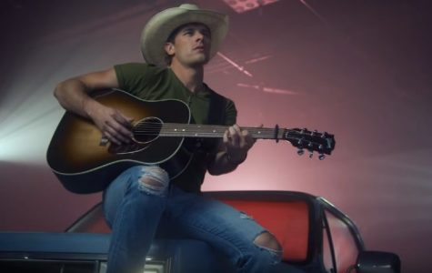King leans up against his loves truck in his music video for