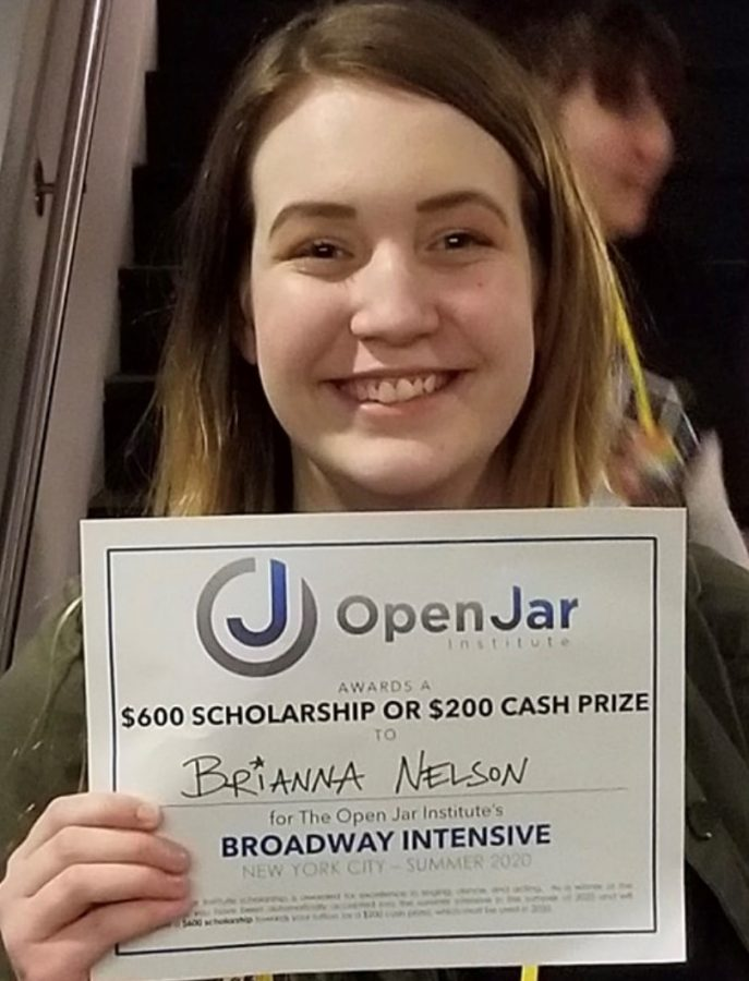 """Holding the result of her hard work, Senior Brianna Nelson showcases her scholarship. Having auditioned a few days prior, the accomplishment was huge in Nelson's dreams of performing. """"The experience of auditioning has taught me that anything and everything is possible if you put your mind to it,"""" Said Nelson. """"Now the experience of the Broadway Intensive? That's to be determined. But I'm sure it's going to be everything I've ever dreamed of and more."""""""