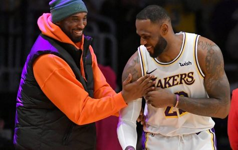 Lakers forward LeBron James banters with the late Lakers legend Kobe Bryant in a game earlier this season. Bryant passed away in a tragic helicopter crash with his daughter and seven others, just the morning after LeBron passed him for the number three spot on the all time scoring list.