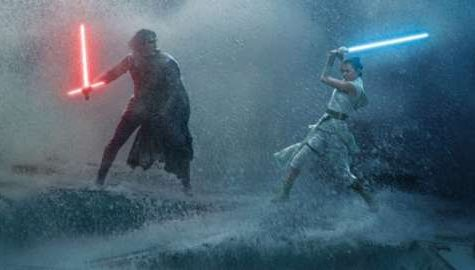 Rey (Daisy Ridley) and Kylo Ren (Adam Driver) battle on top of the remains of the old star.