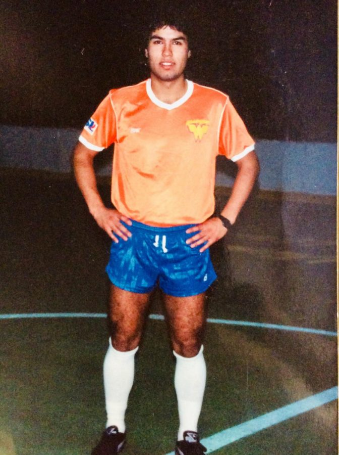 """Spanish teacher and soccer coach, Juan Agurrie poses in an indoor soccer complex for his club team in the United States. He played indoor professional soccer for the Witchita Wings, in Witchita Kansas. """"When I first moved to the United States in 1991 the soccer league was much less developed than it is now,"""" Aguirre said. """"Back then soccer was just starting the develop"""""""