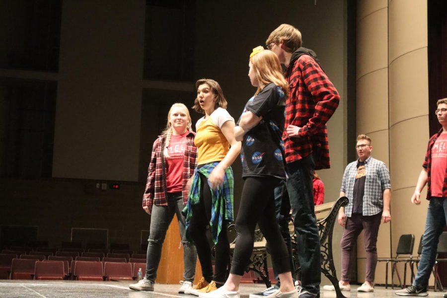 Team space cowboys and flannels seen on the stage collaborating together.