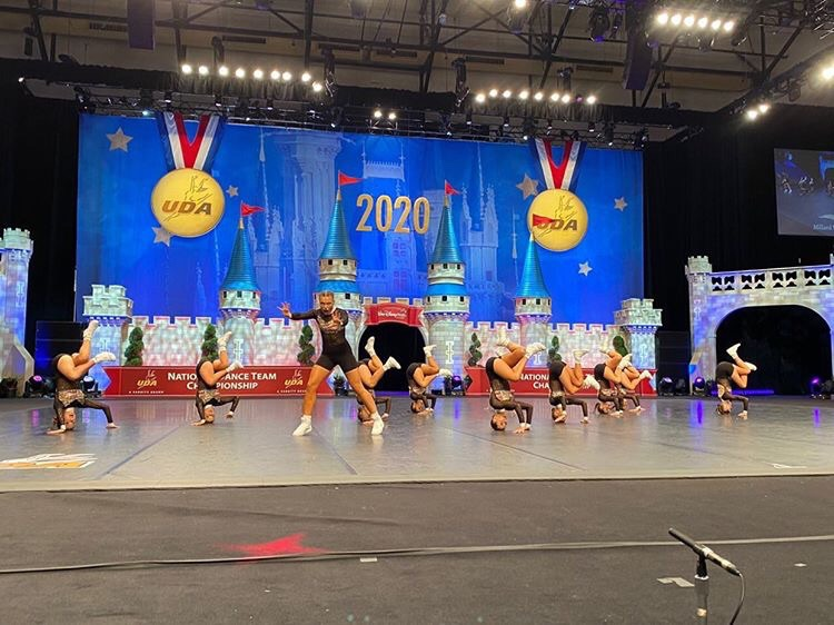 In+this+picture+the+Millard+West+Dance+Team+is+performing+their+hip+hop+routine+on+the+nationals+stage.+They+have+been+working+on+this+routine+for+a+long+time+and+have+been+trying+to+perfect+it+for+a+long+time.+%E2%80%9CDance+is+an+outlet+to+the+outside+world.%E2%80%9D+senior+Molly+Koca+said.+%E2%80%9CYou+get+to+be+with+your+friends+and+tell+a+story+through+movements.%E2%80%9D