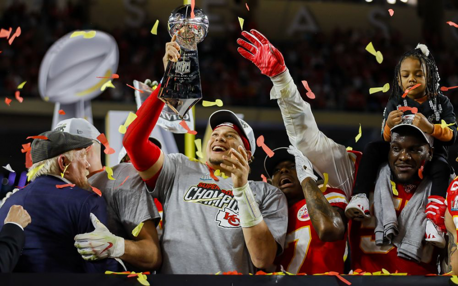 Chiefs+quarterback+Patrick+Mahomes+%28middle%29+raises+the+Lombardi+trophy+as+the+Chiefs+celebrate+their+first+Super+Bowl+win+in+50+years.+Defensive+end+Frank+Clark+%28far+right%29+celebrates+with+his+daughter+on+his+shoulders.