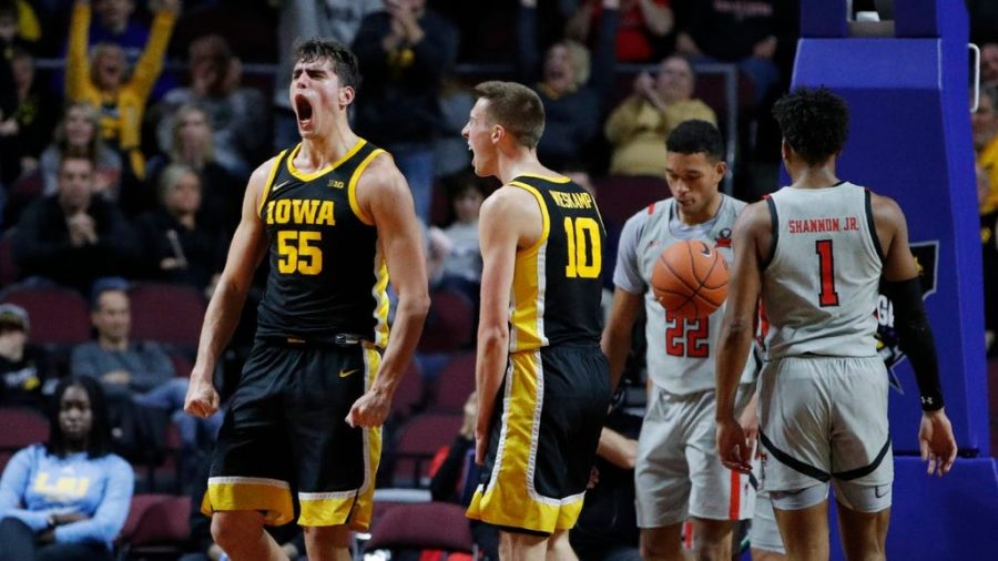 "Iowa's Luka Garza (left) and Joe Wieskamp (right) celebrate an and-one play at the Las Vegas Classic on Thanksgiving 2019. Garza led the Big 10 in points per game (26.2) and is a frontrunner for the Wooden Award. He will enter the tournament as the Big 10 player of the year. ""This is a dream come true,"" Garza said after winning the award. ""Being the first Hawkeye to win this award in 52 years means the world to me."""