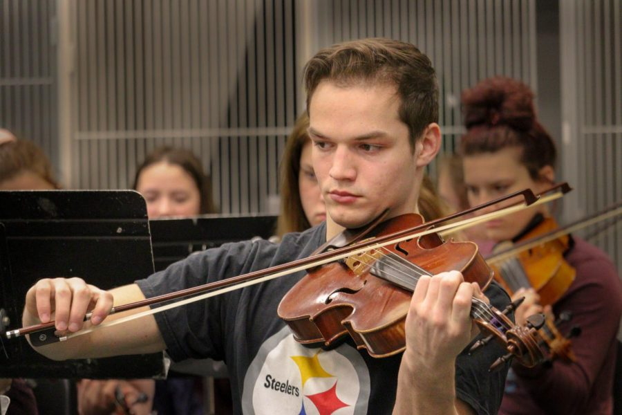 "Senior Ethan Valencia plays his viola during orchestra class. Valencia hopes to attend college on a music scholarship. ""What I learned from doing all these activities is that hard work and dedication defeats all."""