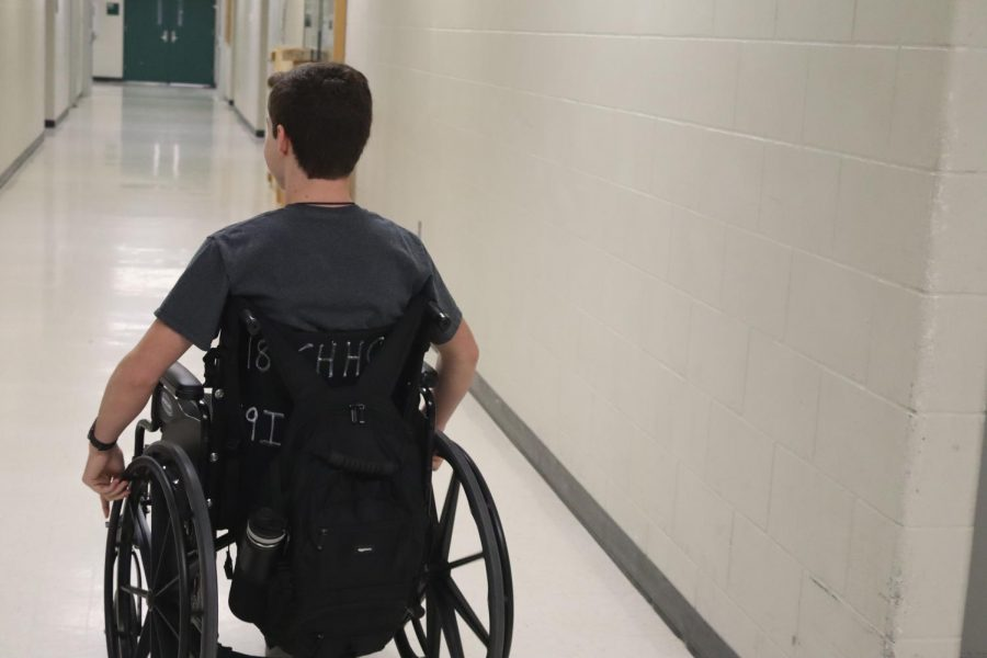 """Heading for the elevator, junior Miles McDonald leaves class just in time to beat the traffic of the crowded school hallways. Usually accompanied by a friend, McDonald has adjusted quickly to his new means of transportation at school. """"Although Miles is totally capable of independent movement, the risks associated with his condition has confined him to a wheelchair,"""" junior Luke Skrabal said. """"Besides the obvious restrictions that come with being in a wheelchair, Miles has also been unable to drive and he travels with an escort wherever he goes in the school."""""""