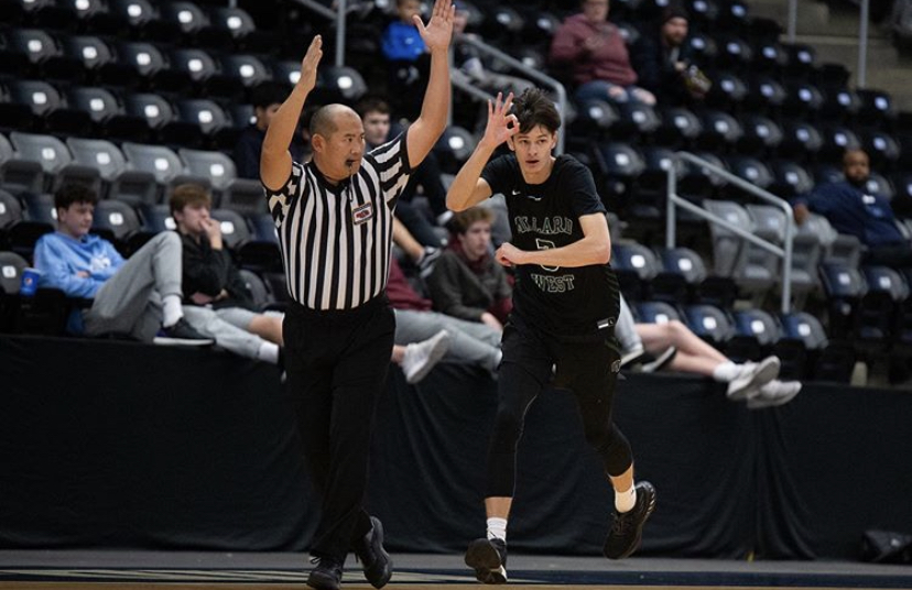 "Senior Zach Olson celebrates a major late game three pointer. Olson has been a huge piece for the Wildcats, but he is ready to move on. ""It's sad leaving this team,"" Olson said. ""But I'm ready for the next step."""