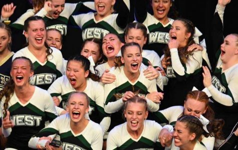 In this picture the Millard West Varsity Cheer team just found out that they had won at state. They won with both their Tumbling and Game Day routine.