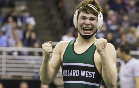 """Senior Nate Hartman celebrates after a  win against Omaha Burke. Hartman  finished sixth in the State tournament. """"A Lot of work went into my season this year. I traveled across the country with the Nebraska National this summer competing in places like Tulsa, Oklahoma to Fargo, North Dakota. I trained everyday at MWC Wrestling Academy, watched my diet to get down to weight, and did hundreds of hours of physical therapy recovering from a dislocated shoulder. My training partner throughout my whole career has been Wyatt May. I wouldn't be where I am today without him pushing me to reach my goals."""""""