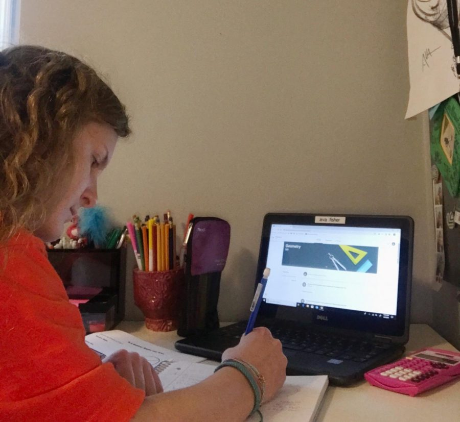 """With remote learning in full swing, sophomore Ava Fisher is able to continue her learning from home. """"Remote learning has overall made me a more organized and responsible student,"""" Fisher said. """"Although it is hard to stay motivated when not in a traditional classroom setting."""" Students are working hard to have a successful school day from the comfort of their homes."""