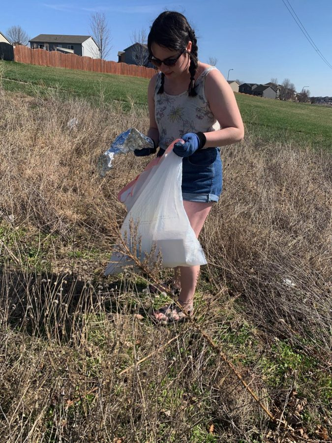 """During quarantine junior Emma Cavalier collects litter around her neighborhood. Cavalier picked up garbage on trails nearby to brighten pedestrians days. """"I think it was helpful during quarantine to inspire others that you can still be involved with your community during these pressing times,"""" Cavalier said. """"It was awesome to see all the trash we had collected, and how much cleaner the environment looked."""""""