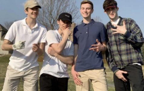 """Four sophomores Mitchell Baird, Jack Byers, Luke Hudek and Aidan MacLeod all pose for a photo after golfing the front nine holes at Eagle Run. """"It was just great to be able to hang with my friends during this,"""" Hudek said. """"I didn't think we'd be able to all do it together, but we did, and it was totally worth it."""""""