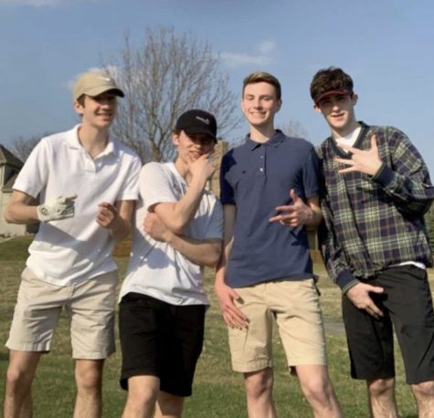 "Four sophomores Mitchell Baird, Jack Byers, Luke Hudek and Aidan MacLeod all pose for a photo after golfing the front nine holes at Eagle Run. ""It was just great to be able to hang with my friends during this,"" Hudek said. ""I didn't think we'd be able to all do it together, but we did, and it was totally worth it."""