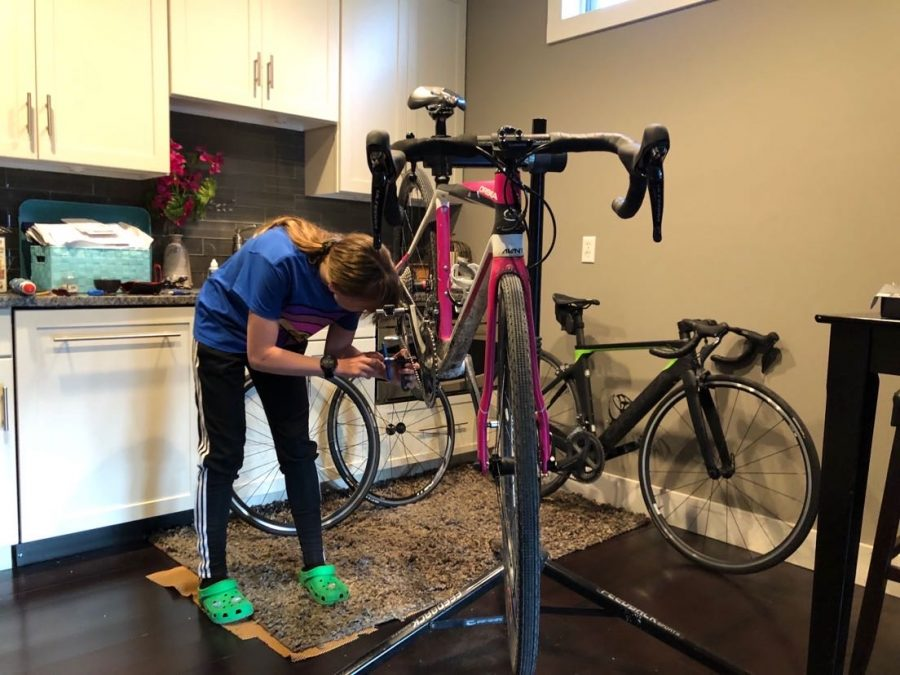 Sophomore Emmi Gilbert works to repair her gravel bike. She has been working towards becoming a bike mechanic and has been learning to repair while in quarantine. Gilbert hopes to soon turn her passion for cycling into business repairing bikes for people in Omaha.