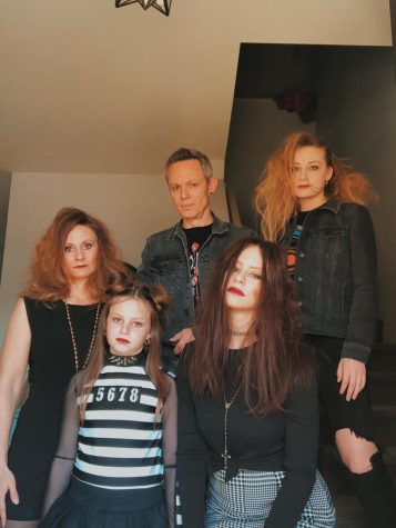 "The Mike family poses for a timer picture on their Goth/ New Wave themed night. The family has been holding family themed nights every Friday where they dress up and do activities together. ""We watched Karate Kid for goth night, mostly because my dad was super into goth/new wave in the 80's and he loves Karate Kid,"" Milina Mike said."