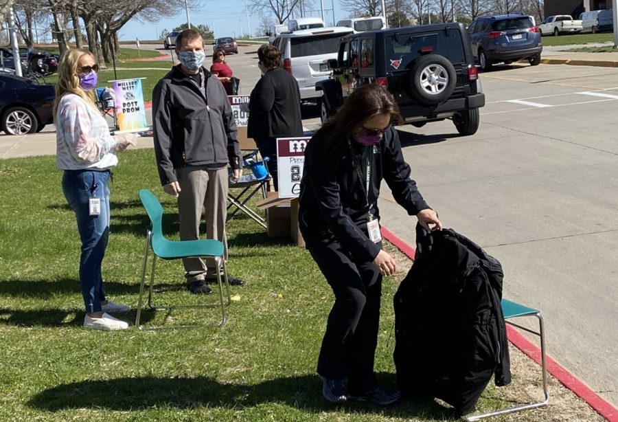 Principal Dr. Greg Tiemann shared a photo on Twitter showing what he and many others were doing at the school on April 21. While wearing masks and practicing safe social distancing, staff members and other volunteers helped to hand out yard signs and Post Prom gift bags to the graduating seniors.