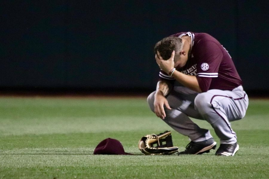 Mississippi+State%E2%80%99s+Elijah+MacNamee+crouches+on+the+field+after+a+tough+loss+to+Louisville+in+the+2019+College+World+Series.+%0A%0AFor+the+first+time+in+70+years%2C+Omaha+won%E2%80%99t+be+hosting+the+eight-team+tradition%2C+which+is+an+extreme+blow+to+the+city.+The+city+has+long+prided+itself+on+hosting+the+tournament+and+in+2009+spent+%24100+million+to+build+TD+Ameritrade+Park+in+exchange+for+an+NCAA+promise+to+keep+the+CWS+through+at+least+2035.+Canceling+the+CWS+alone+will+cost+the+local+economy+%2470+million%2C+and+is+a+huge+loss+for+the+businesses+and+vendors+that+surround+TD+Ameritrade+Park.+