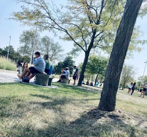 This is the front of Millard West High school where they have now opened for lunch. In this photo you can see many students enjoying eating outside. Outside dining is important and should continue to be in place. Students seem to be happier, less stressed and are enjoying the nice weather.