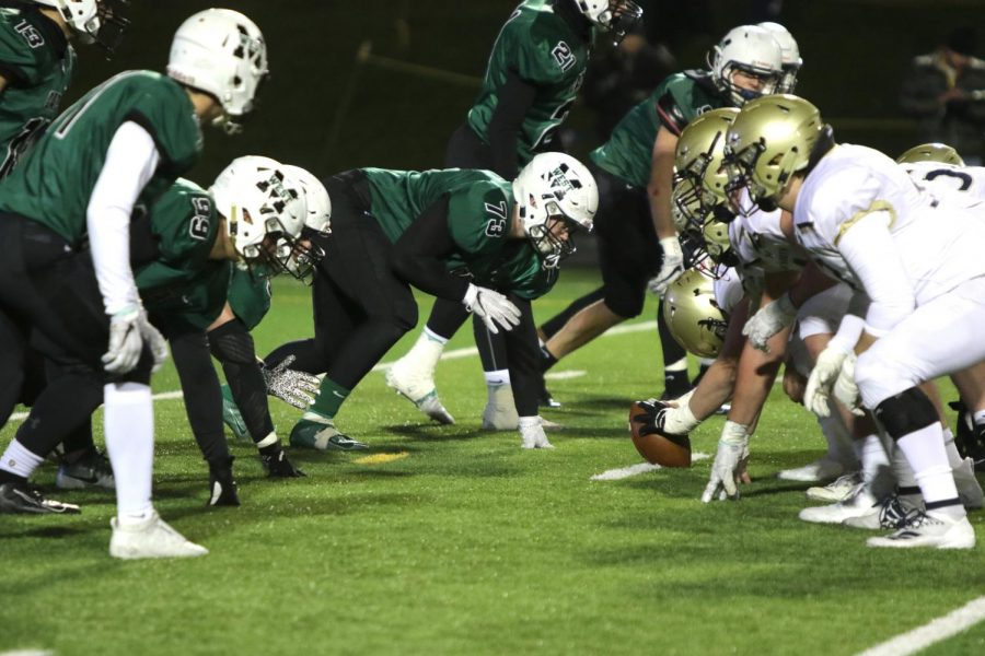 """The Millard West defense waits anxiously for the snap against Elkhorn South in last year's second round matchup against the Storm. The Wildcats beat the Storm in this game 35-21. """"I was really proud of how far we got as a team last year,"""" senior running back Zach Coleman said. """"I wouldn't trade last season for anything else."""""""