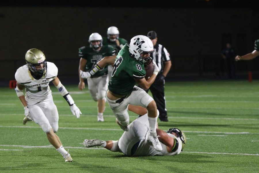 Millard+West+takes+on+Elkhorn+South+at+Buell+Stadium+in+week+1+of+High+School+Football.+Senior+wide+receiver+Dustin+Hatch+catches+the+ball+at+the+45+yard+line+for+a+12+yard+gain.+