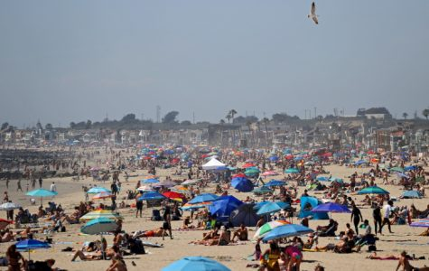 Huntington beach is packed with vacationers, April 25, 2020. Not a single mask in sight, nor was social distancing considered.
