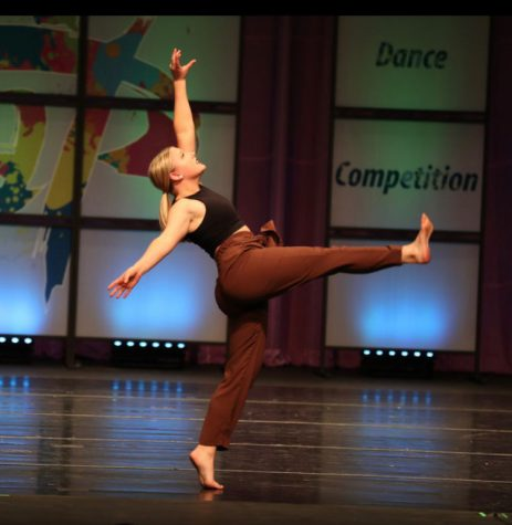 "Senior Vivien Gaines performs for judges at a local dance competition. ""My style of dancing is mostly based around musicality and how I can portray the music with the movement,"" Gaines said. ""I'm a big fan of using music that isn't traditionally used and playing around with how I can change the way the music is perceived with dancing."""