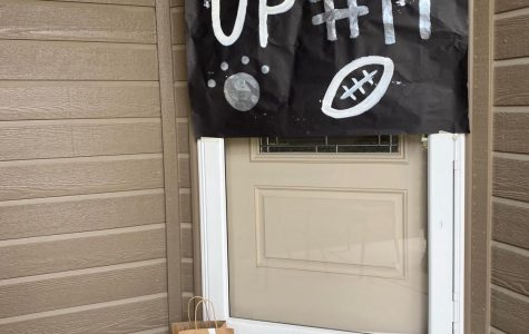 "Posters were painted and hung on each player's front door. The team wanted to surprise the seniors with an assortment of items and snacks as well. ""We painted the football stripe and design on the brown paper bags"", senior Phoebe Rackliffe said. It's always a fun time with the team when we make different things like this."